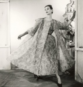 ca. 1954 --- Model wearing paisley silk organdy dress and coat, both by Balenciaga. --- Image by © Condé Nast Archive/CORBIS