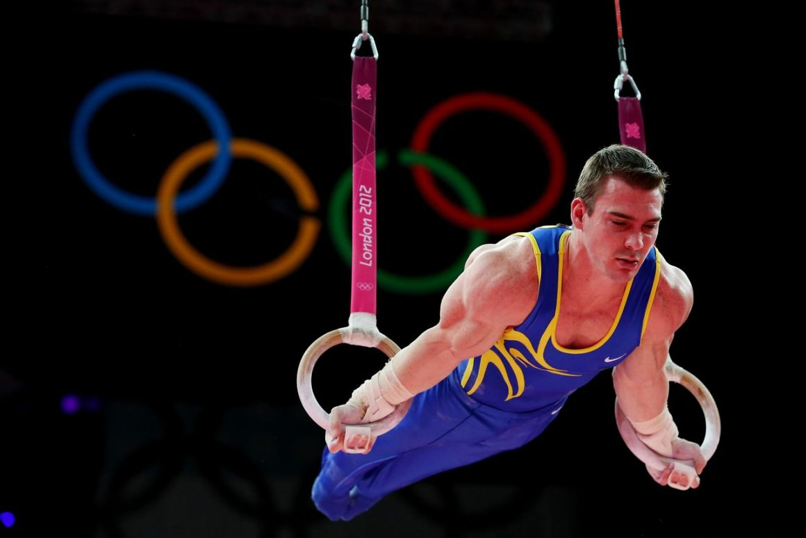 LONDON, ENGLAND - AUGUST 06: Arthur Nabarrete Zanetti of Brazil competes on the Artistic Gymnastics Men's Rings on Day 10 of the London 2012 Olympic Games at North Greenwich Arena on August 6, 2012 in London, England. (Photo by Ronald Martinez/Getty Images)