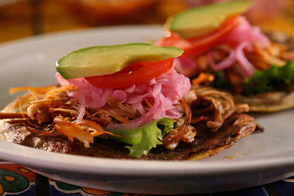 WS of the Panuchos dish from Chichen Itza in Los Angeles, CA as seen on Food Network's Diners, Drive-Ins and Dives episode DV2212.